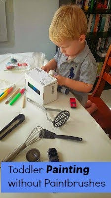 Toddler Painting without Paintbrushes