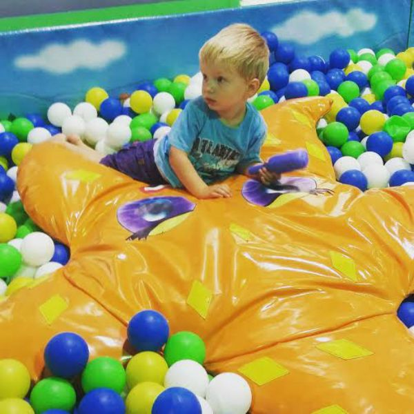 Watching him jump into the balls at softplay....