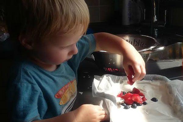 strawberries into yogurt