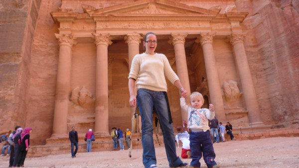 The Toddler and I standing in front of the Treasury