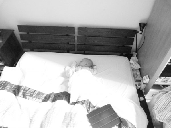Said Flat Pack Bed with one Baby fast asleep - c.2012