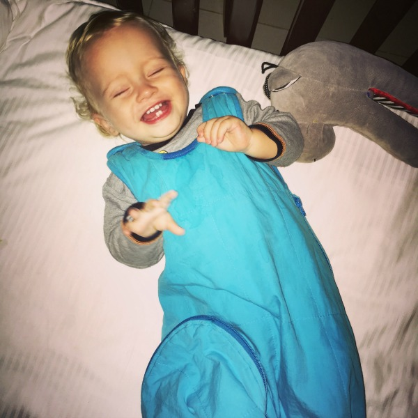 Baby laughing in the cot