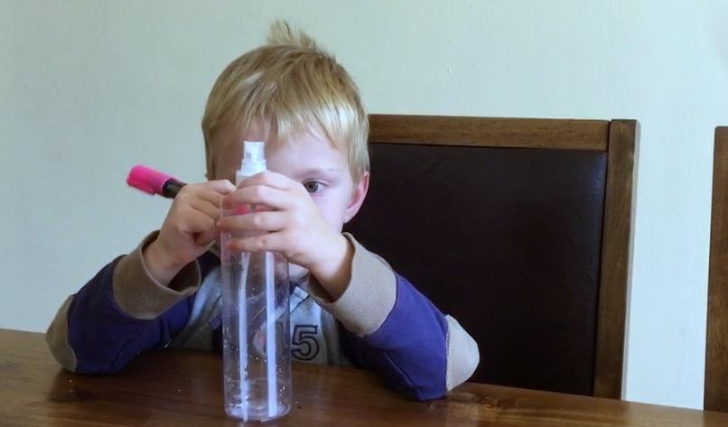 making a lavender oil monster spray bottle with chalkola