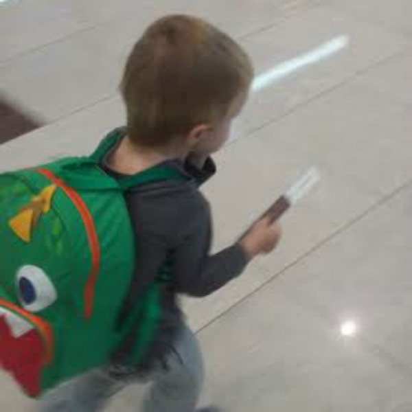 Running through the airport, passport in hand