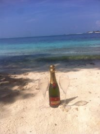 champagne on the beach in the maldives