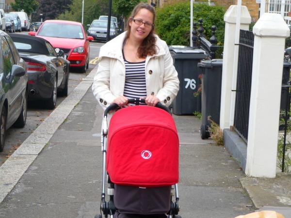 mum walking baby in pram