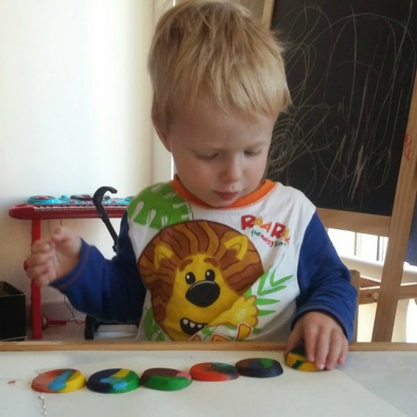 colouring with rainbow crayons