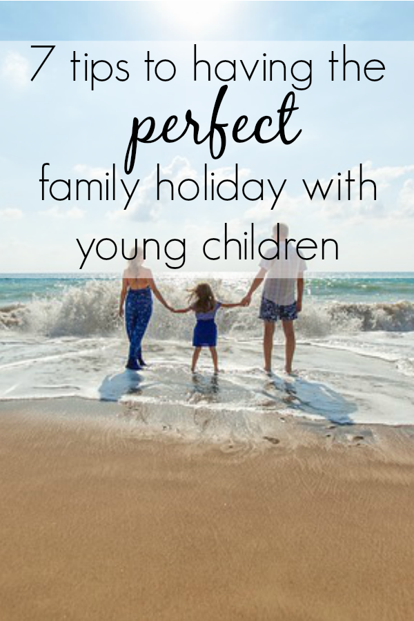 7 Tips to having the perfect family holiday with young children - family on a beach