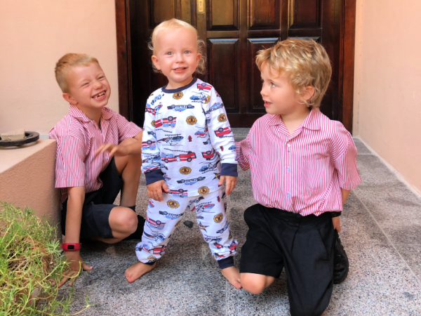 two boys in school uniform and baby