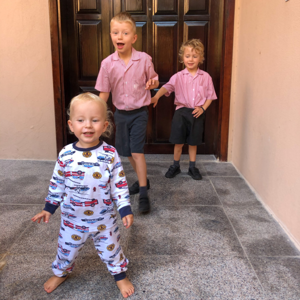 back to school photo - two boys in school uniform and baby