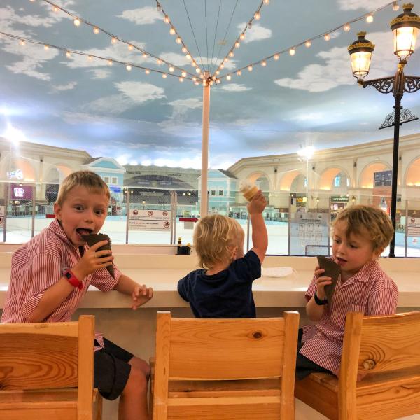 three boys at villaggio mall doha eating ice cream