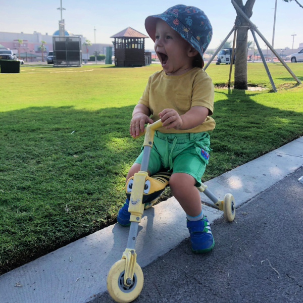 toddler on trike at park