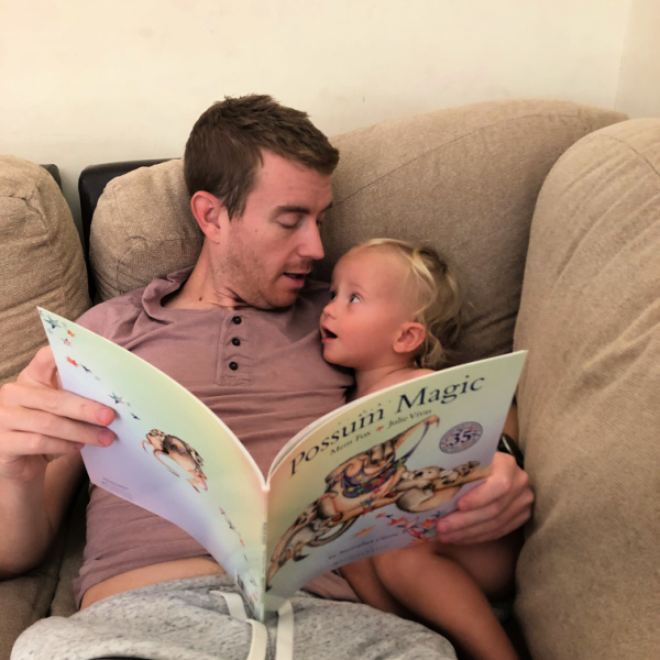 father and son reading story together