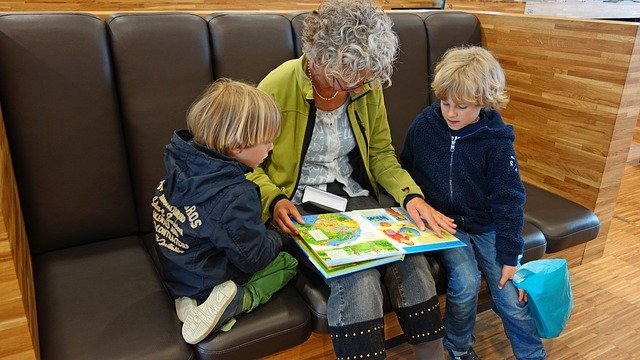 adult reading with two children